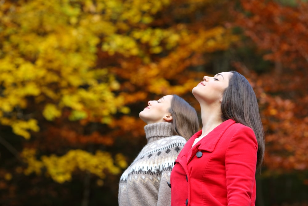 Two women soaking up the beauty of their getaway while enjoying all of the great things to do in Lanesboro this fall